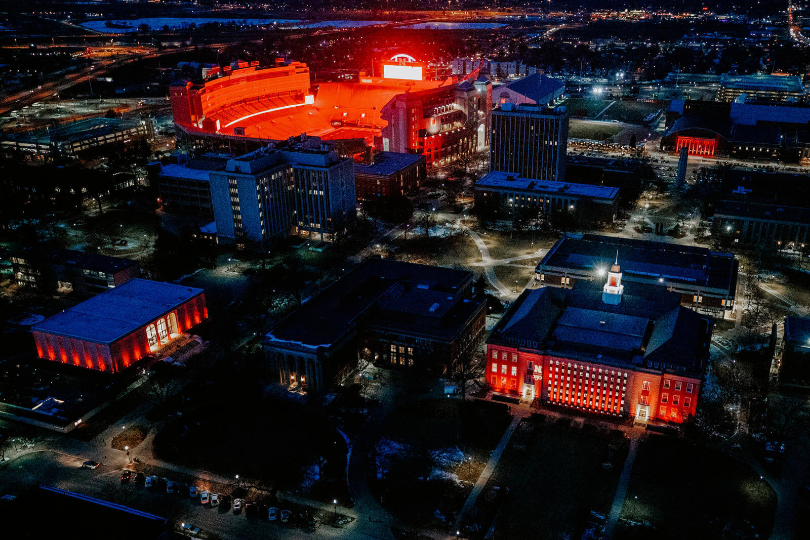 Red lights light up Memorial Stadium at night